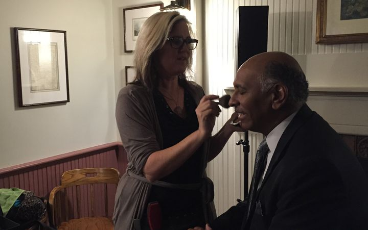 Kriss Blevens applies makeup to former RNC Chairman Michael Steele.