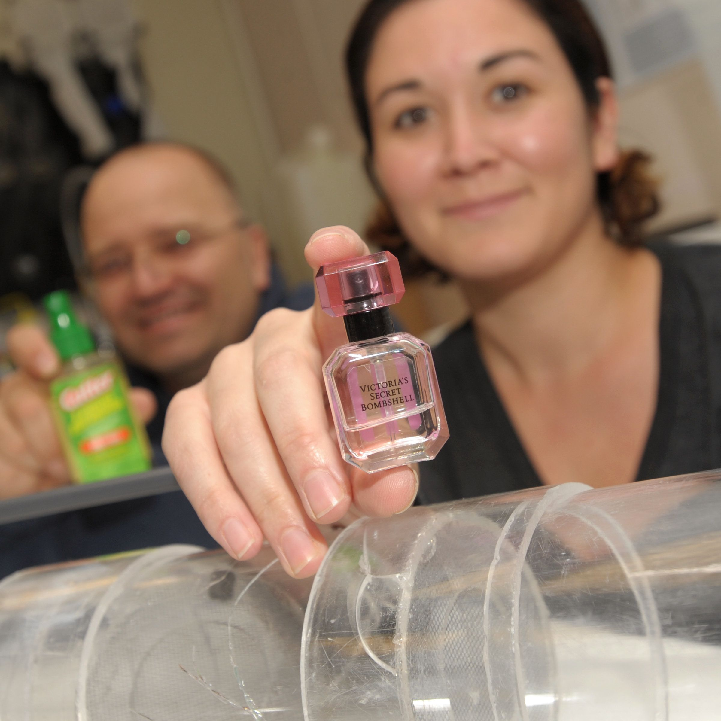 NMSU biology professor Immo Hansen (left) and research assistant Stacy Rodriguez (right) display household products they test