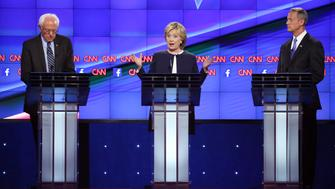 Senator Bernie Sanders, an independent from Vermont, from left, Hillary Clinton, former U.S. secretary of state, and Martin O'Malley, former governor of Maryland, participate in the first Democratic presidential debate at the Wynn Las Vegas resort and casino in Las Vegas, Nevada, U.S., on Tuesday, Oct. 13, 2015. While tonight's first Democratic presidential debate will probably lack the name-calling and sharp jabs of the Republican face-offs, there's still potential for strong disagreements between the party's leading contenders. Photographer: Josh Haner/Pool via Bloomberg