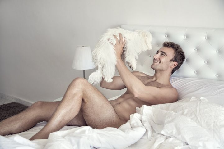 Lucas Etienne cuddles with a furry friend.