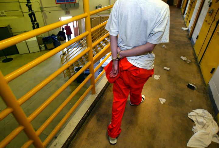 A young offender walks handcuffed from his cell at the Nixon facility at the Fred Nelles CYA facility in Whittier, California, which is now closed.