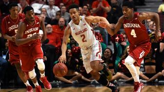 CHICAGO, IL - MARCH 13: Maryland Terrapins guard Melo Trimble (2) pushes off Indiana Hoosiers guard Robert Johnson (4) as he runs the ball down court during the first half of the Big 10 Men's Basketball Tournament game between the Maryland Terrapins and the Indiana Hoosiers at the United Center on Friday, March 13, 2015. (Photo by Toni L. Sandys/The Washington Post via Getty Images)