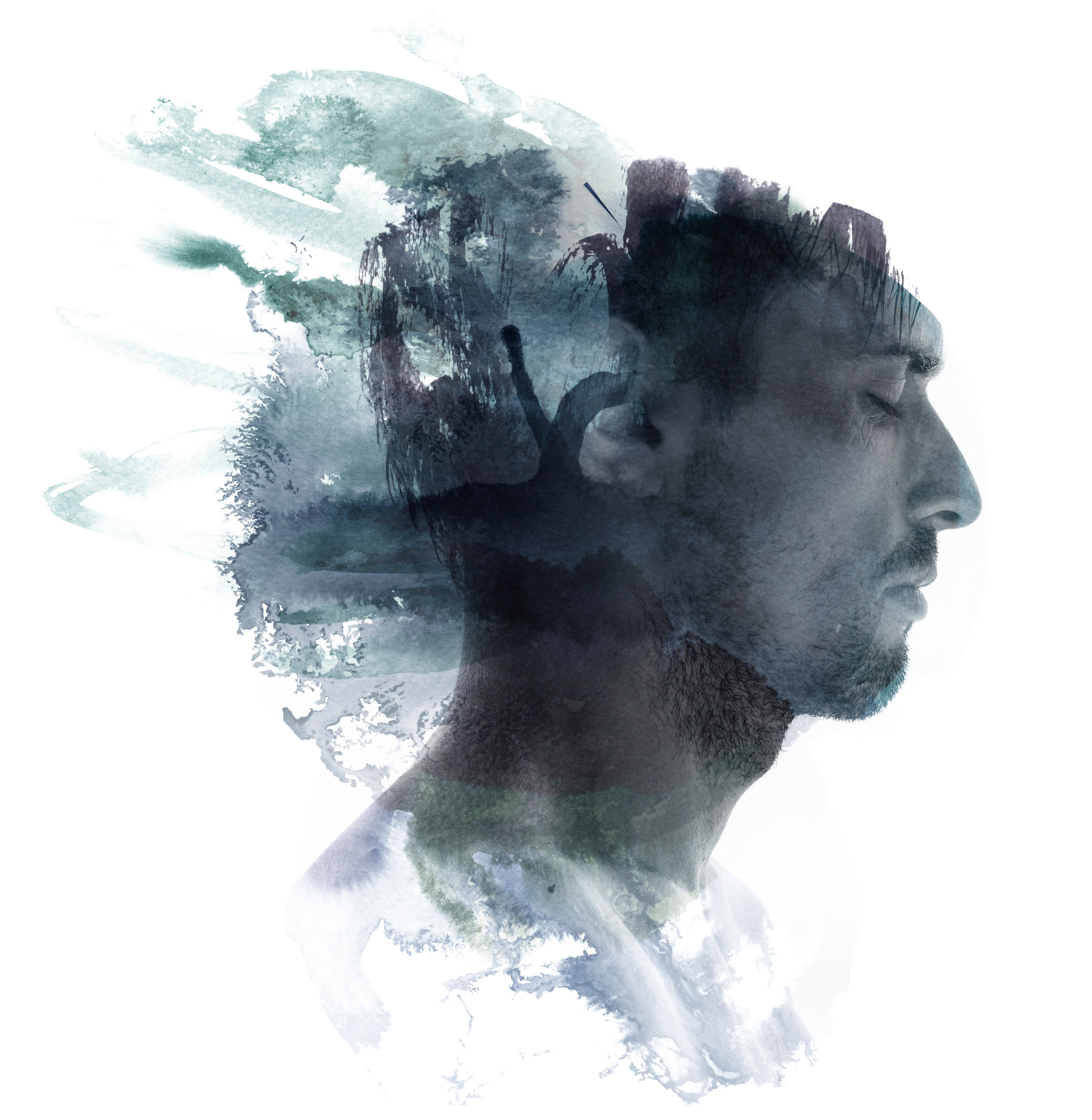 Meditative portrait of attractive man combined with watercolor drawing