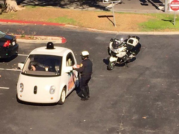 A Google self-driving car is pulled over for going too slow by a Mountain View, California police officer.