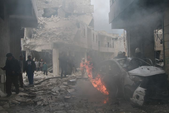 ALEPPO, SYRIA - APRIL 12: Syrian firefighters try to extinguish the fire in a burning car that burst into flames in the Syria