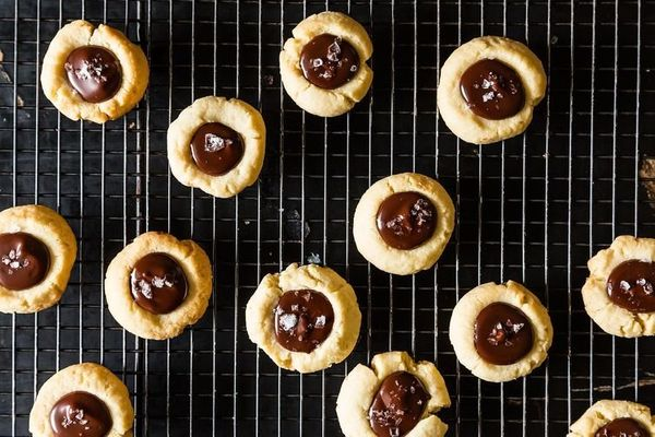 "<strong>Get the <a href=""http://food52.com/recipes/17837-almond-thumbprint-cookies-with-dark-chocolate-and-sea-salt"" target="""
