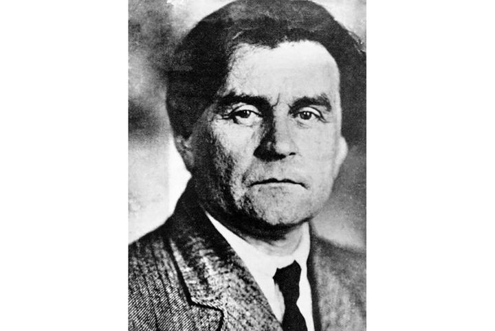 """<a href=""""https://commons.wikimedia.org/wiki/File:Casimir_Malevich_photo.jpg"""">The Russian avant-garde master's artistic influe"""