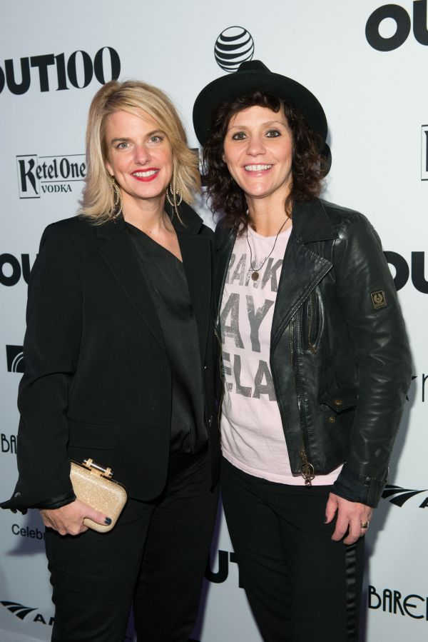 President of GLAAD, Sarah Kate Ellis and guitarist, Kristen Henderson walk the red carpet at the OUT100 Gala, presented by Le