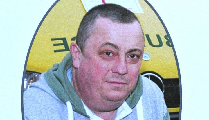 A photo of Alan Henning is seen on a handout for his memorial service in 2014.