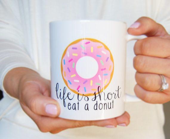 "Get the <a href=""https://www.etsy.com/listing/219026935/donut-judge-me-mug"">Life Is Short, Eat A Donut mug</a>."
