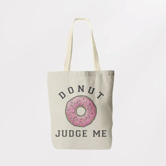 """Get the <a href=""""https://www.etsy.com/listing/253099924/vintage-style-donut-judge-me-printed"""">Donut Judge Me tote</a>."""