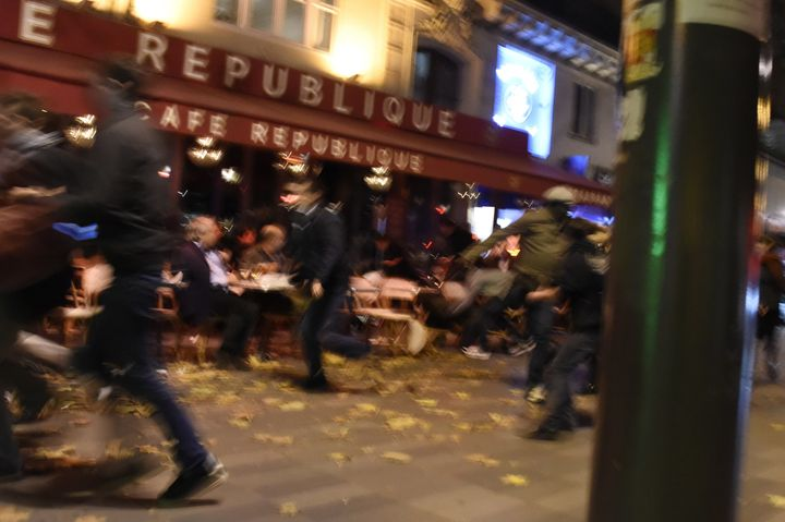 People run after hearing what is believed to be explosions or gunshots near the Place de la Republique square.