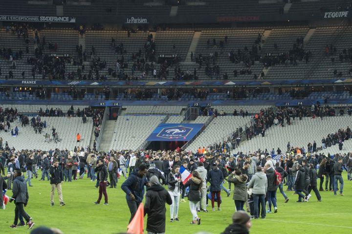 Supporters run in panic on the pitch during the friendly match between France and Germany at the Stade France in Paris, Franc