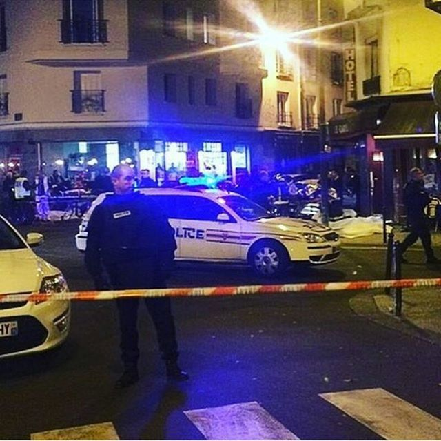 Police block off streets bear Boulevard Voltaire in Paris, France after attacks rocked the city on November 13, 2015.