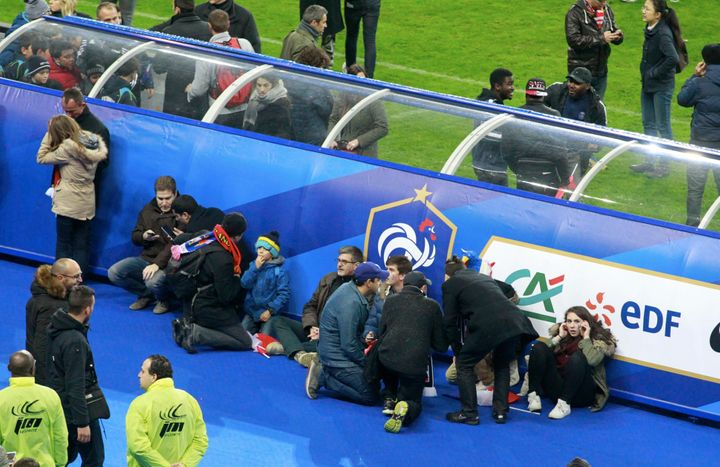 Spectators wait on the pitch during the game between France and Germany at Stade de France on November 13, 2015 in Paris, Fra