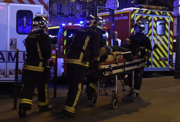 """<span class='image-component__caption' itemprop=""""caption"""">Rescuers workers evacuate a man on a stretcher near the Bataclan concert hall in central Paris, on November 13, 2015. A number of people were killed and others injured in a series of gun attacks across Paris, as well as explosions outside the national stadium where France was hosting Germany. AFP PHOTO / DOMINIQUE FAGET (Photo credit should read DOMINIQUE FAGET/AFP/Getty Images)</span>"""