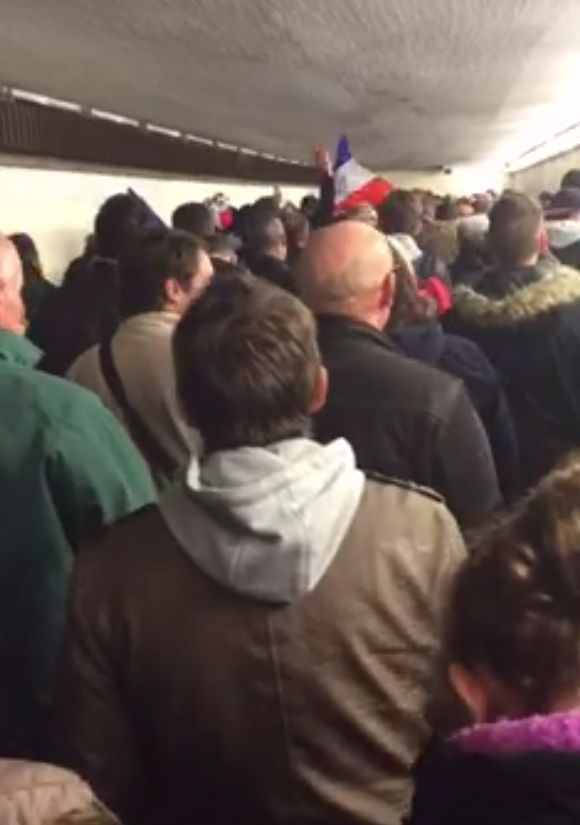 "Fans leave the Stade de France singing ""La Marseillaise,"" the French national anthem"