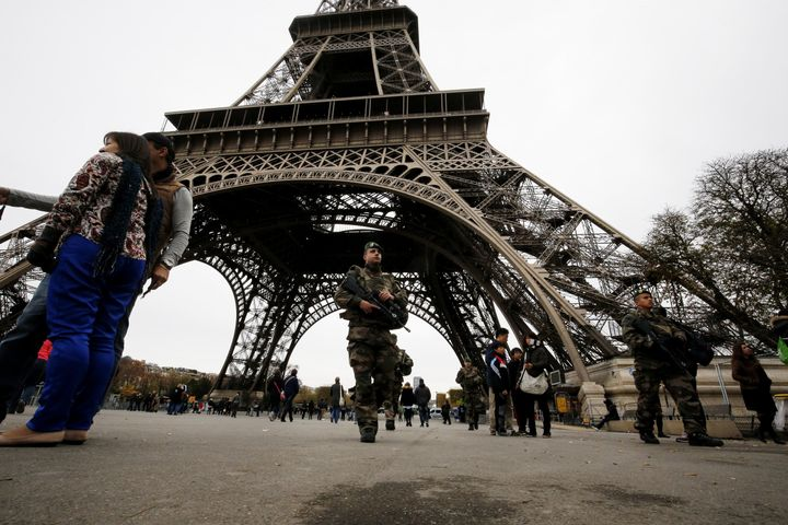 French soldiers patrol the area at the foot of the Eiffel Tower in Paris on Nov. 14, 2015.