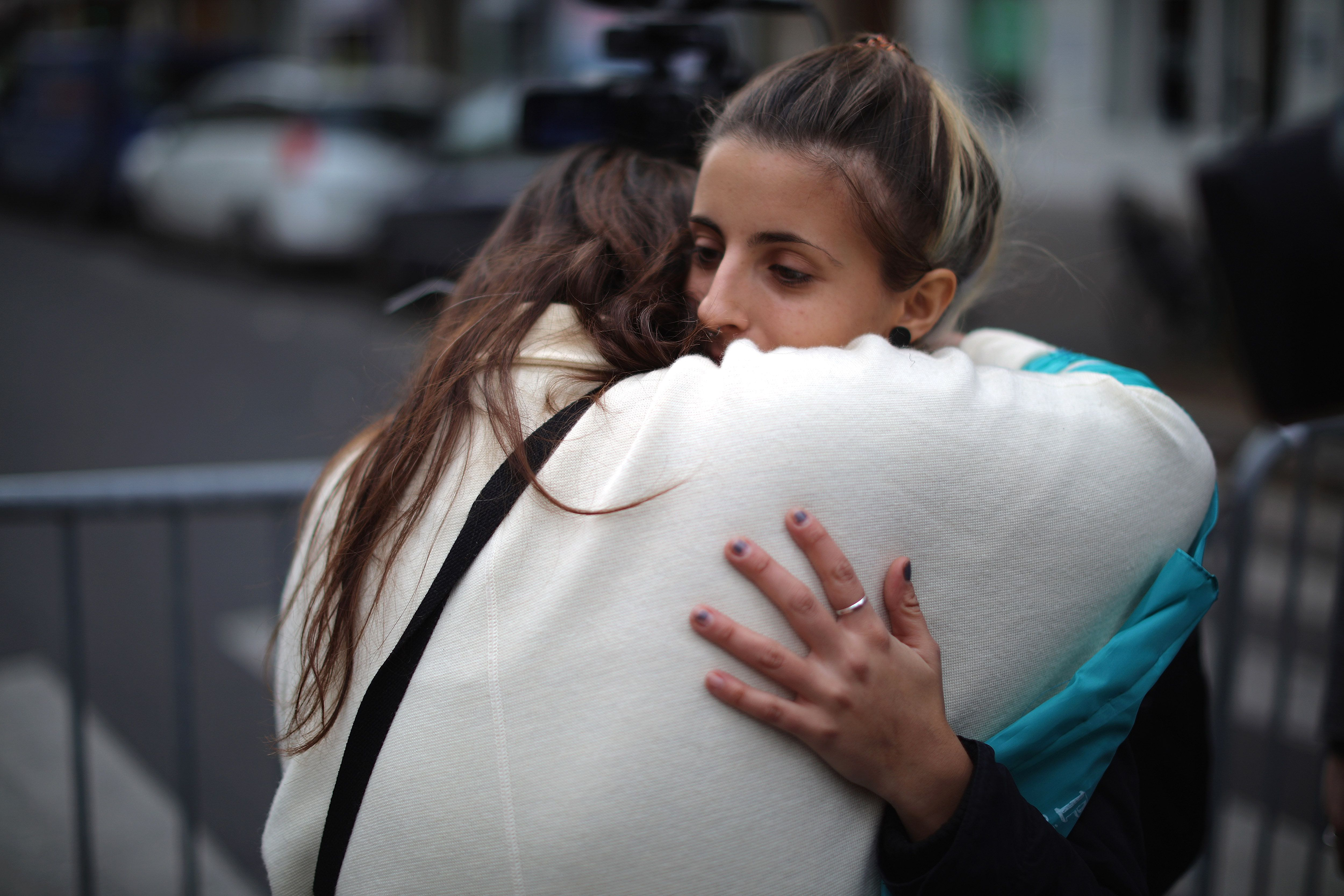 PARIS, FRANCE - NOVEMBER 14:  Women console each other near the scene of the Bataclan Theatre terrorist attack on November 14, 2015 in Paris, France. At least 120 people have been killed and over 200 injured, 80 of which seriously, following a series of terrorist attacks in the French capital.  (Photo by Christopher Furlong/Getty Images)