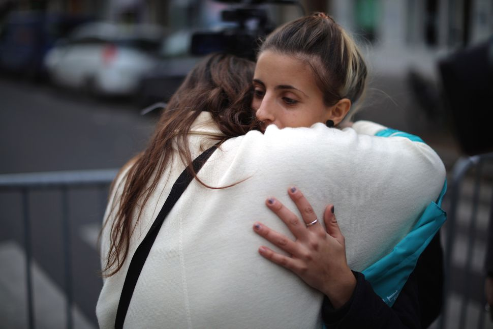Women console each other near the scene of the Bataclan Theater terrorist attack on Nov. 14, 2015 in Paris, France.
