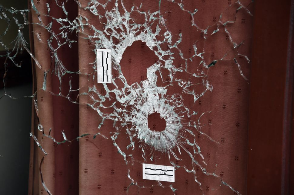 Bullet holes scar the windows of the Carillon and the adjacent Cambodian restaurant on Rue Alibert in the 10th district of th