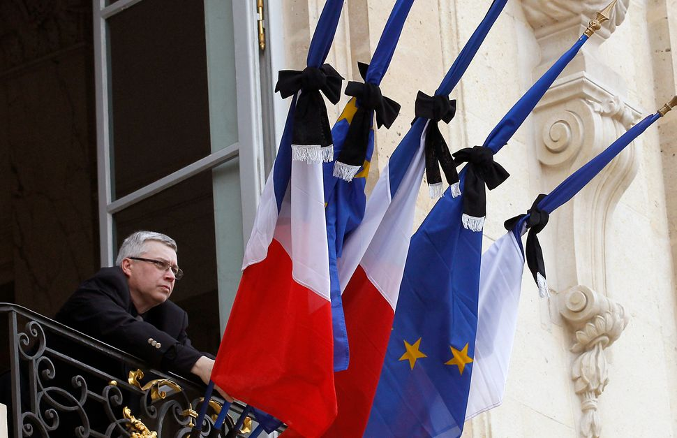 French flags are set at half mast after French president Francois Hollande declared three days of national mourning at the El