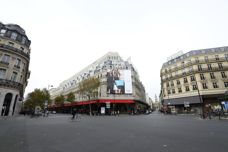 The street outside the landmark Galleries Lafayette department store in Paris stands largely deserted on Nov. 14, 2015, as ma
