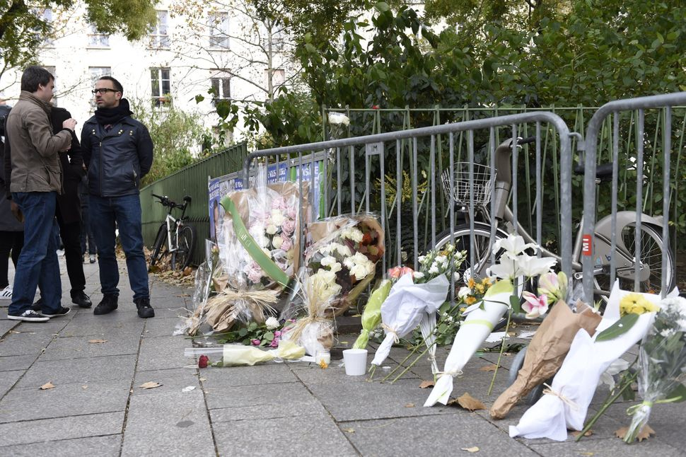 Flowers laid along a fence cordon close to the Bataclan theatre in the 11th district of Paris, on Nov. 14, 2015.