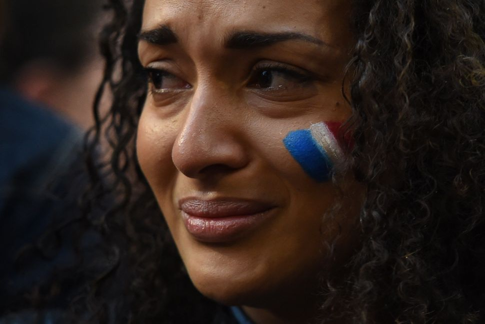 A woman weeps at a vigil held by the local French community in Sydney on Nov. 14, 2015.
