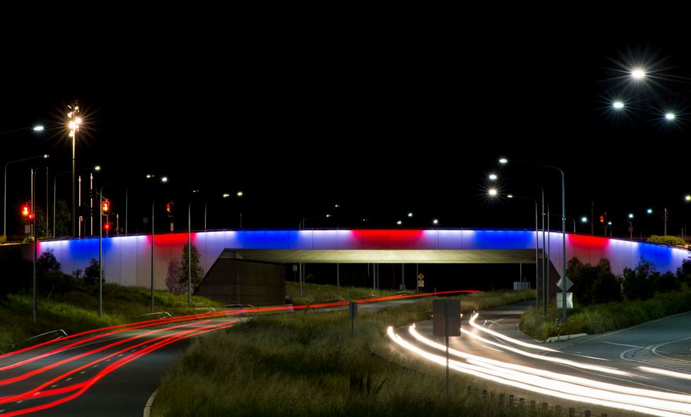 Kings Avenue Bridge, Parliamentary Triangle is illuminated with the colors of the French flag on Nov. 14, 2015, in Canberra,