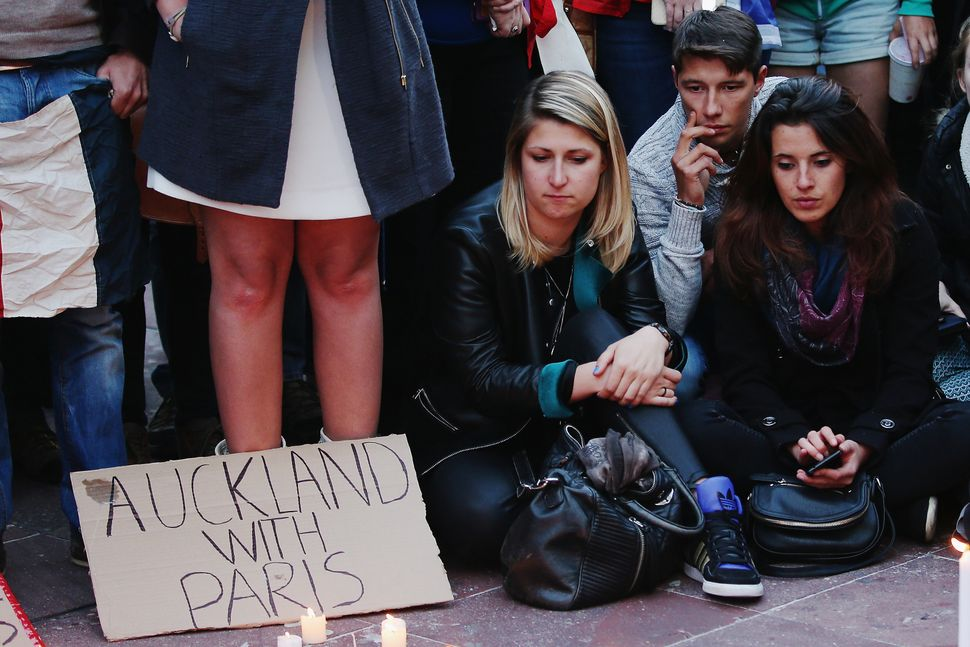 People gather during a vigil in Aotea Square on Nov. 14, 2015 in Auckland, New Zealand, to remember victims of the Paris atta