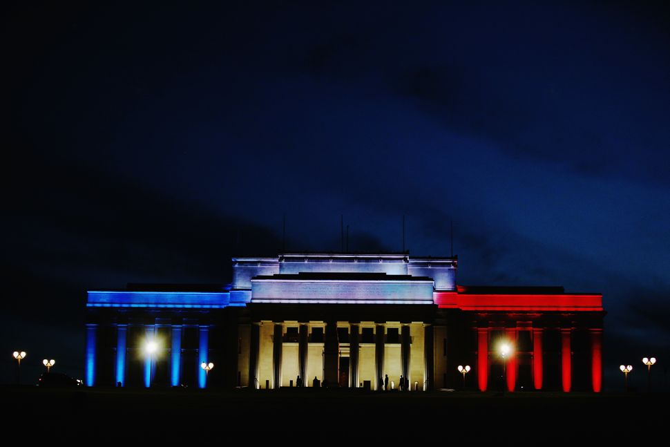 Lights in the colors of the French flag light up the Auckland Museum to remember victims of the Paris attacks on Nov. 14, 201