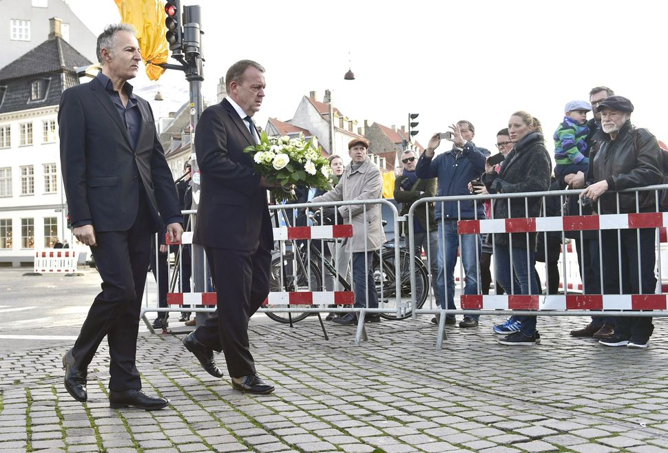 Danish Prime Minister Lars Loekke Rasmussen (second from left) and the French ambassador to Denmark Francois Zimeray arrive t