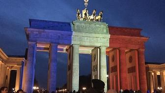 The Brandenburg Gate is lit in solidarity with Paris on Saturday, Nov. 14, 2015 in Berlin, Germany.