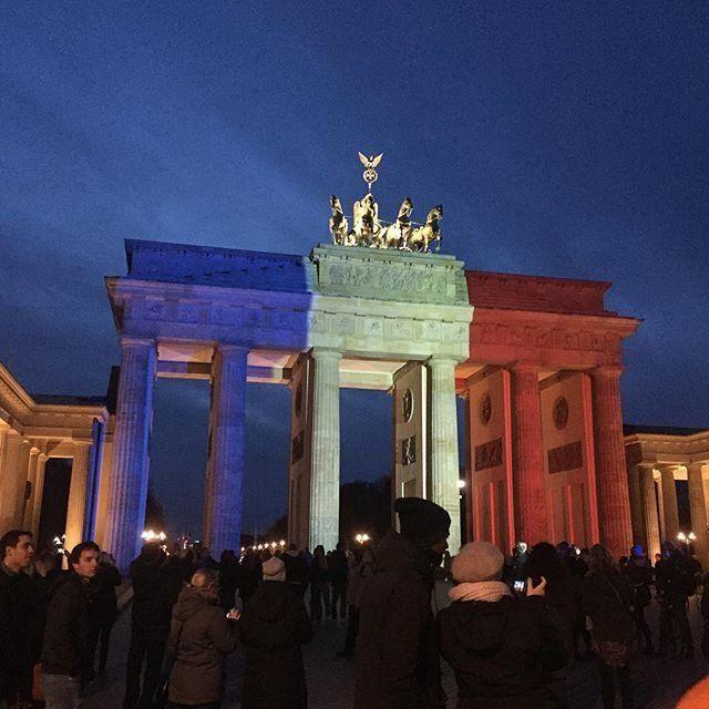 The Brandenburg Gate is lit in solidarity with Paris on Saturday, Nov. 14, 2015, in Berlin, Germany.