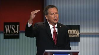Republican presidential candidate John Kasich speaks during the Republican Presidential Debate hosted by Fox Business and The Wall Street Journal November 10, 2015 in Milwaukee, Wisconsin. AFP PHOTO/JOSHUA LOTT        (Photo credit should read Joshua LOTT/AFP/Getty Images)