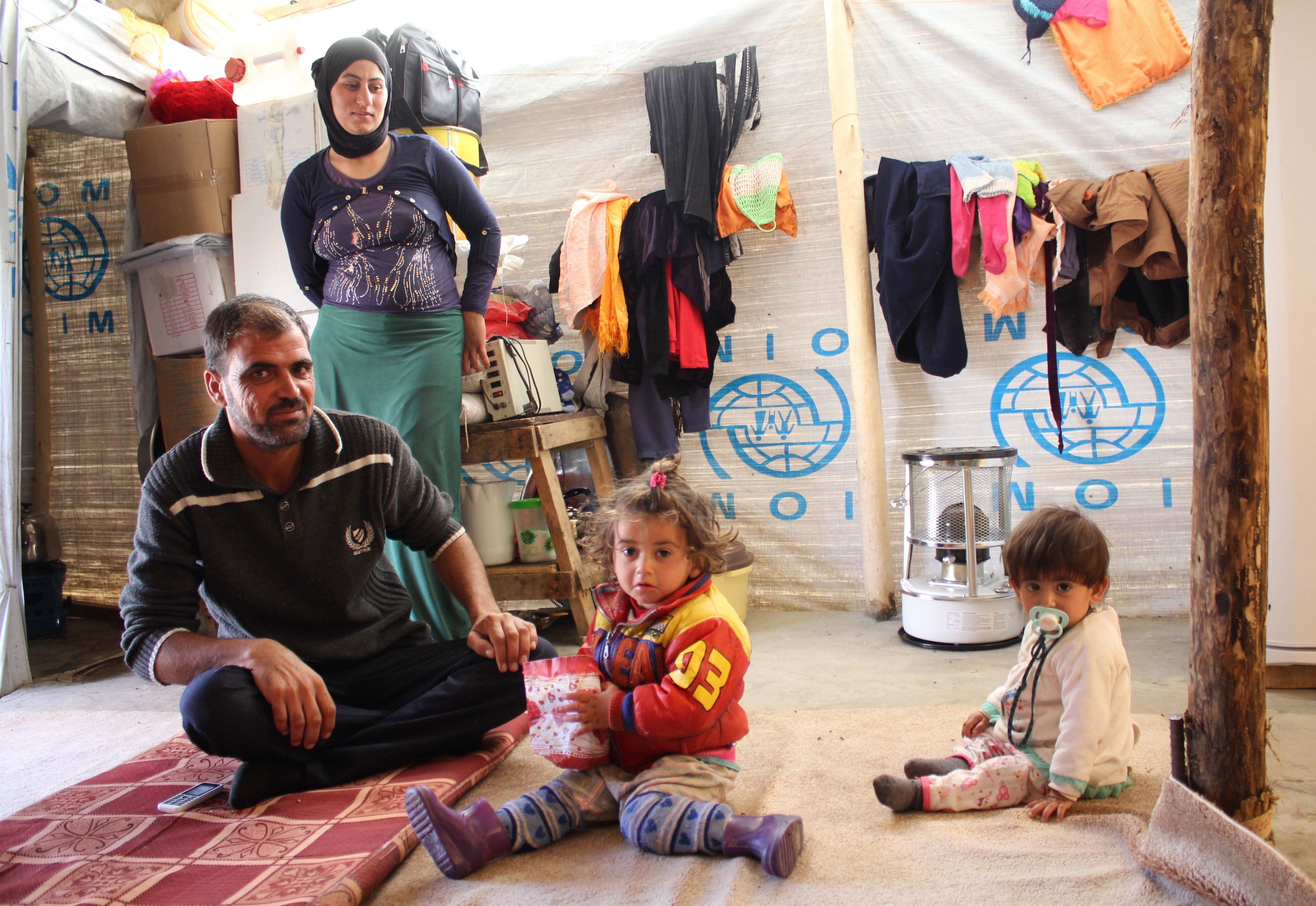 A Yazidi family of four in the makeshift shelter they hope to soon leave when they return to Sinjar.