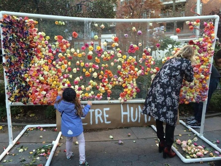 Mourners hung flowersnearthe Washington arch in NYC to pay their respects alongside Parisians.
