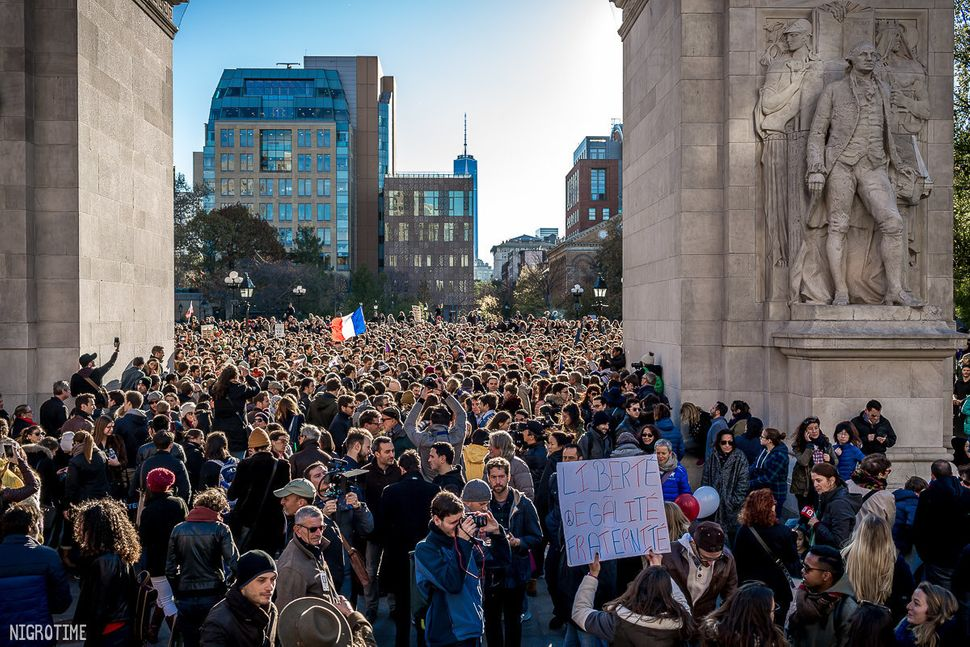 Supporters gather in Washington Square Park in New York City to show support for Paris on Saturday Nov. 14, 2015.
