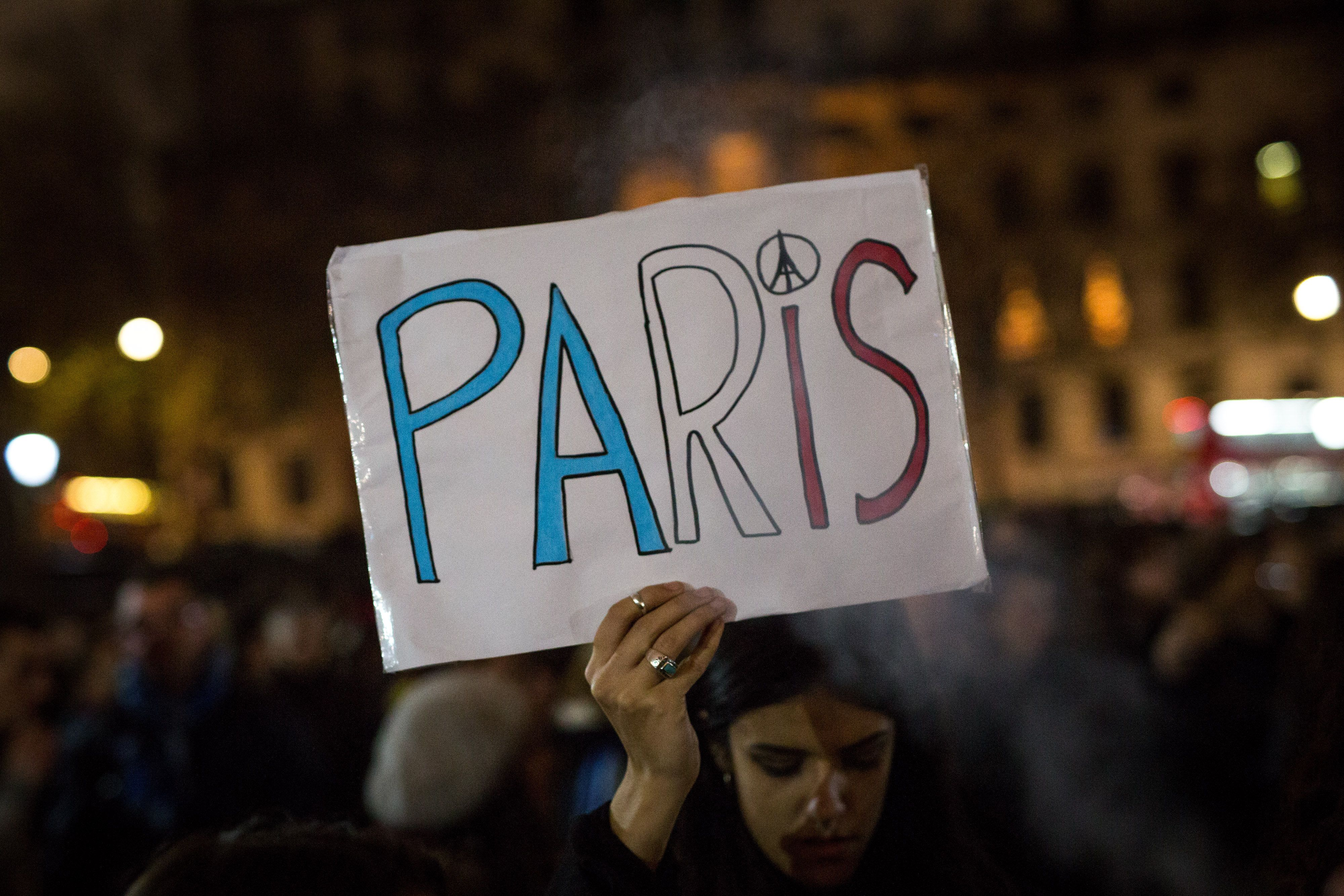 As people at vigils around the world, such as this one in London, remembered Paris on Saturday, Syrians in Paris looked for w