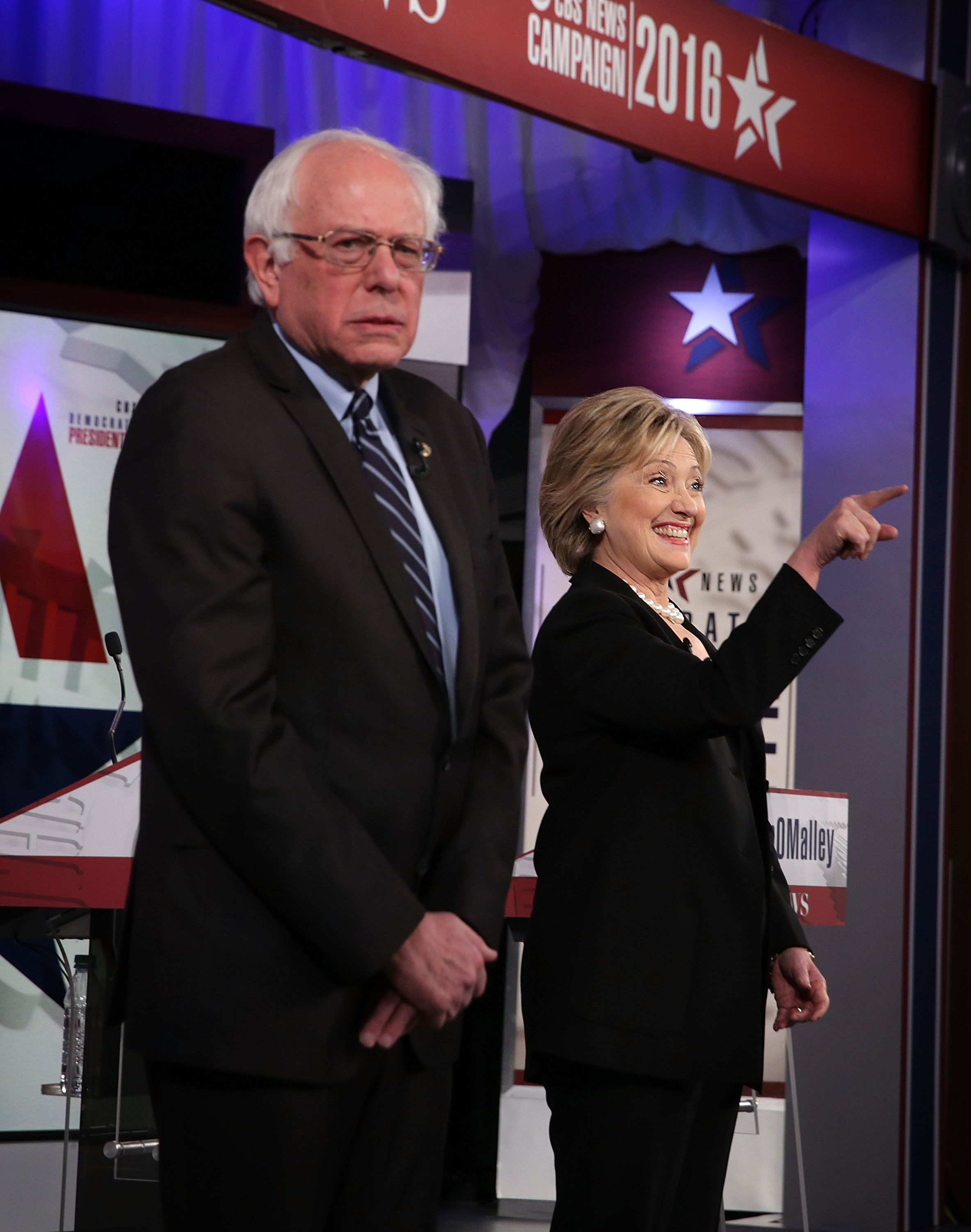 Democratic presidential candidates Sen. Bernie Sanders (I-Vt.) and Hillary Clinton stand on the stage prior to thepresi