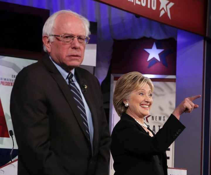 Democratic presidential candidates Sen. Bernie Sanders (I-Vt.) and Hillary Clinton stand on the stage prior to the presi