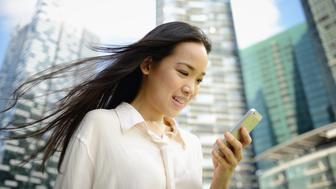 Young woman using smart phone, close-up.