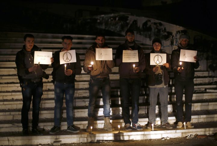 Syrians have held demonstrations paying respect to those killed in Paris.