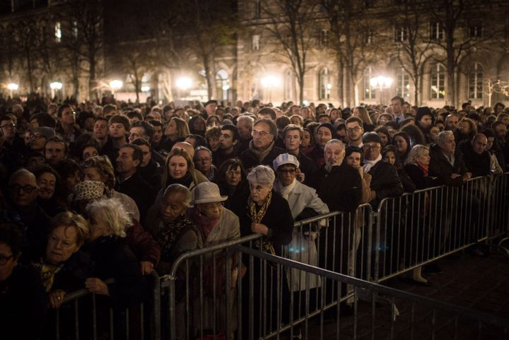 People gather outside of Notre Dame cathedral on Nov. 15, 2015, ahead of a ceremony to the victims of Friday's terrorist atta