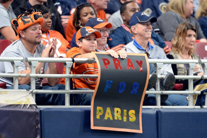 A young fan at the Edward Jones Dome in St. Louis, Missouri, displays a sign in support for the people of Paris during the se