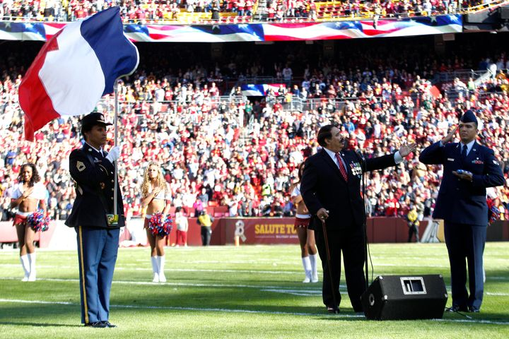 Pre-game ritualsat FedExField in Landover, Maryland, incorporatedthe French flag before theWashington NFL t