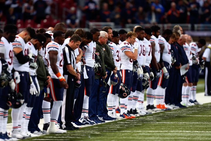 Chicago Bears players stand for a moment of silence before theirgame against the St. Louis Rams at the Edward Jones Dom