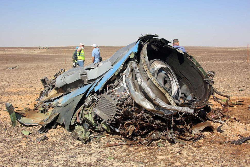 SUEZ, EGYPT - NOVEMBER 01: A plane part is seen as the Egyptian officials inspect the crash site of Russian Airliner in Suez,