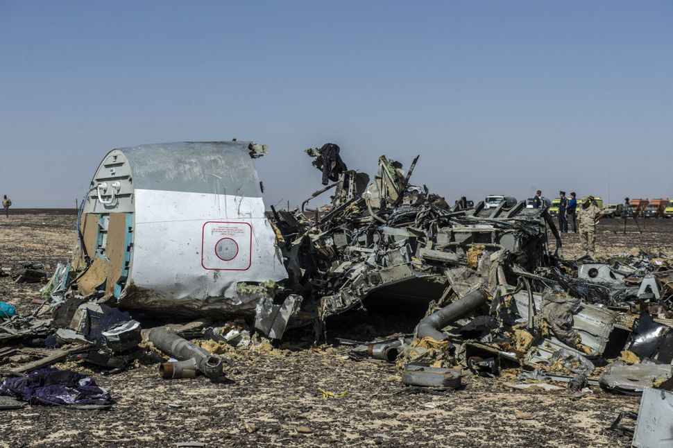 Debris of the A321 Russian airliner lie on the ground a day after the plane crashed in Wadi al-Zolomat, a mountainous area in